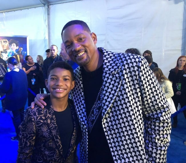 Lonnie Chavis (Left) as seen while smiling for a picture alongside Will Smith at the El Capitan Theatre in December 2019