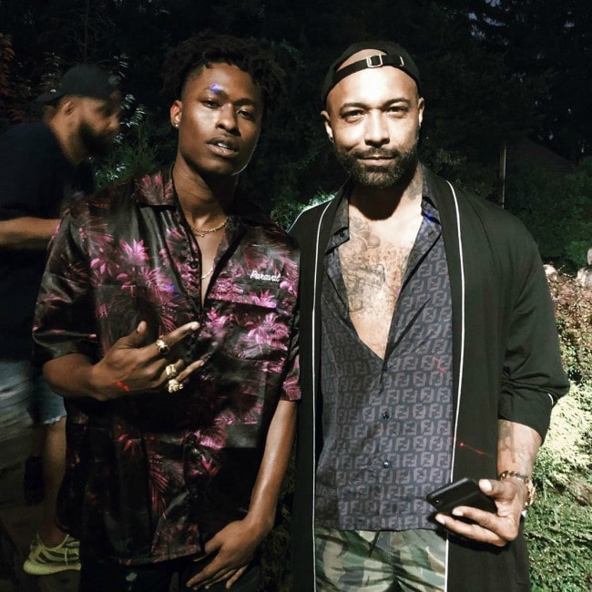 Lucky Daye (Left) as seen while posing for the camera along with Joe Budden