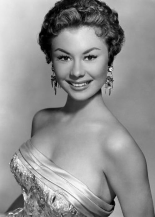 Mitzi Gaynor as seen while smiling for the camera c. 1954