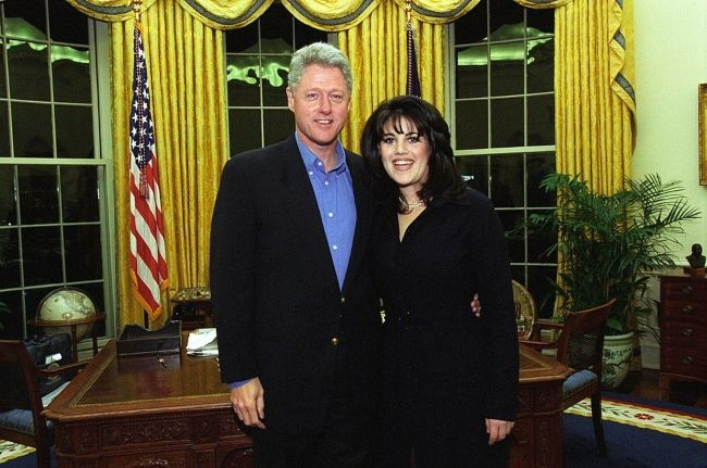 Monica Lewinsky posing with President Bill Clinton in the 1990s