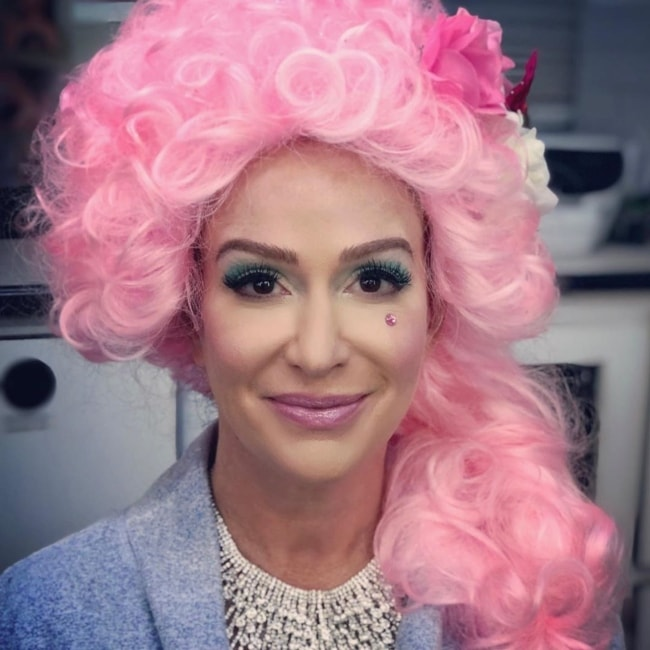 Rebecca Creskoff as seen in a closeup picture while sporting a pink wig in July 2019