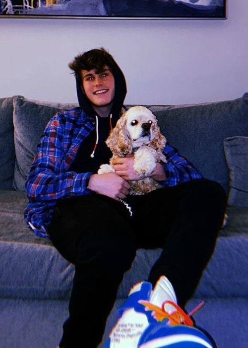 Ryan Wauters with his dog as seen in March 2020