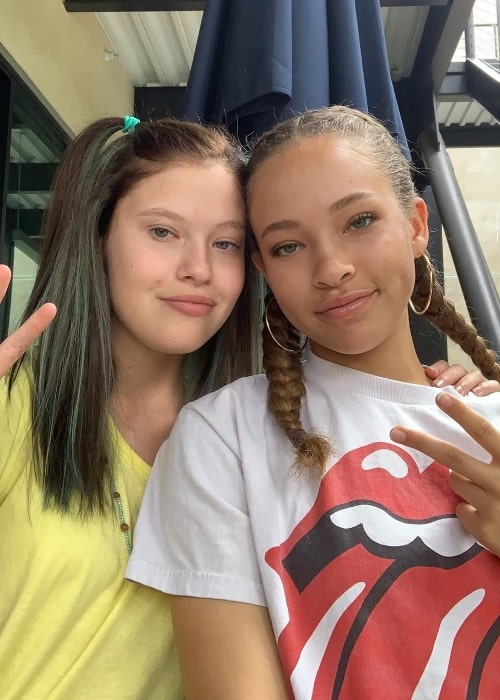 Shelby Simmons (Right) smiling for a picture along with Ella Gibbs in July 2019