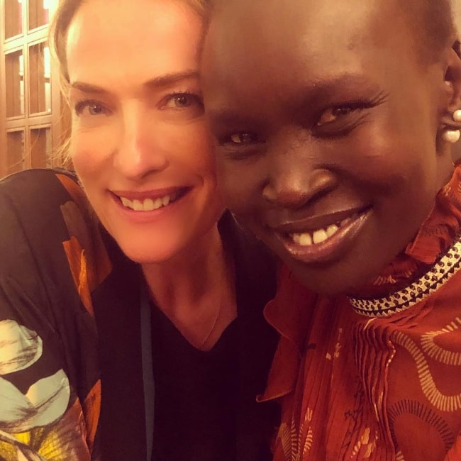Tatjana Patitz (Left) as seen while smiling for a picture along with Alek Wek in Milan in February 2019