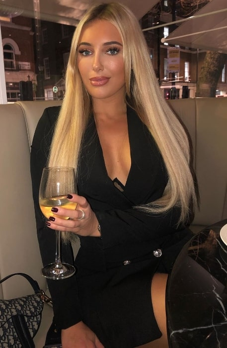 Amber Turner looking stunning in a black dress for a date night at Bloomsbury Street Kitchen in January 2020