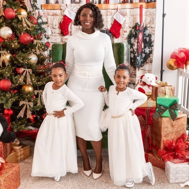Ami McClure as seen in a picture taken with her daughters Ava and Alexis in December 2019