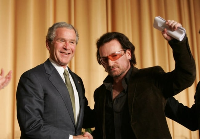 Bono (Right) and then-U.S. President George W. Bush shaking hands in 2006