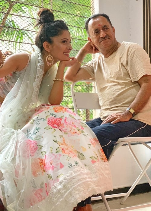 Charlie Chauhan as seen in a picture alongside her father