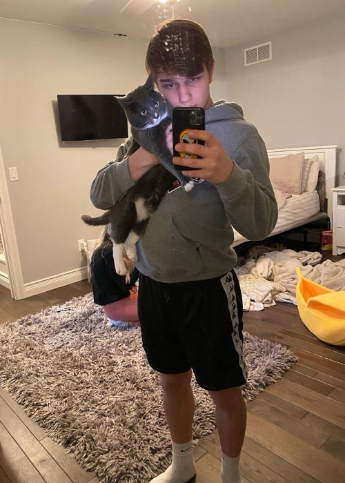 Chase Matthew as seen in a selfie taken with his cat in March 2020
