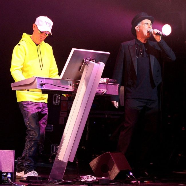 Chris Lowe (left) and Neil Tennant performing in a Pet Shop Boys concert in 2006