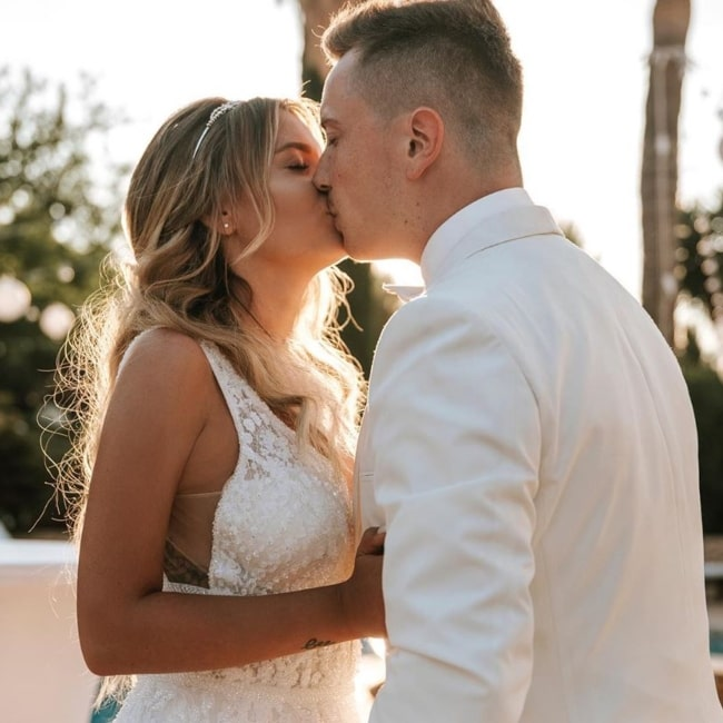 Dagi Bee as seen in a picture that was taken in June 2020, with her husband creative director Eugen Kazakov sharing a romantic moment