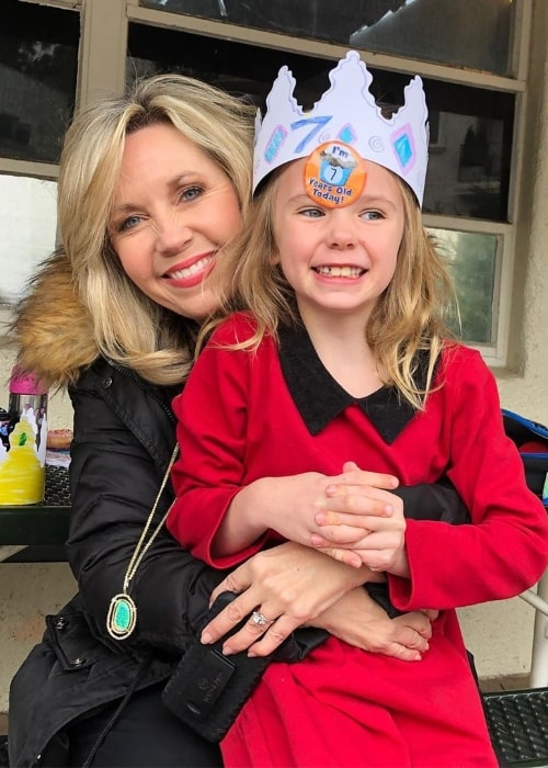 Deb Carson smiling in a picture alongside her daughter celebrating her 7th birthday in December 2019