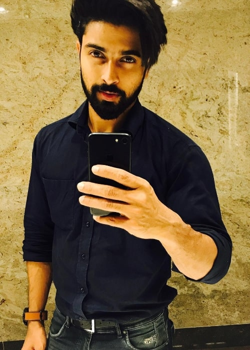 Dev Mohan as seen while taking a mirror selfie in February 2018