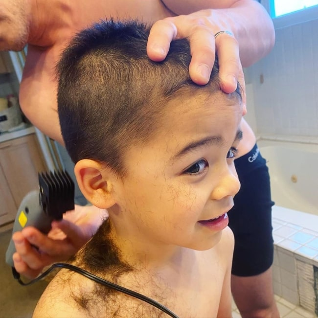 Ford Walker as seen in a picture getting his hair trimmed off by his father Ross in April 2020