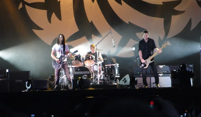 From Left to Right - Chris Cornell, Matt Cameron, and Ben Shepherd as seen while performing with Soundgarden at Lollapalooza in Chicago in August 2010