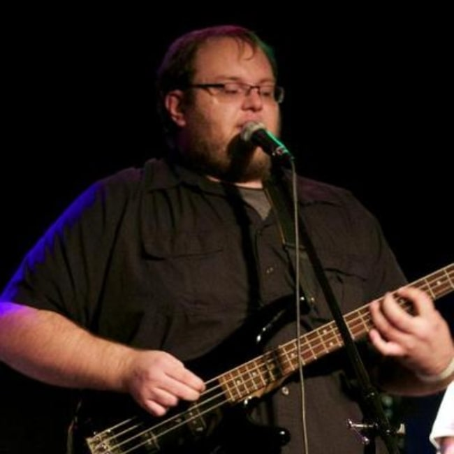 Gary Brolsma as seen in a picture while playing the bass guitar during a concert