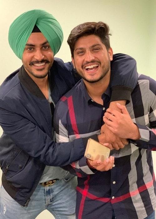 Gurnam Bhullar (Right) smiling in a picture alongside Rajvir Jawanda