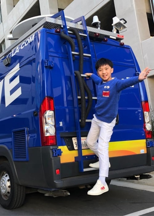 Ian Chen in a picture taken while hanging of the ladder of a 5 Live van in March 2019