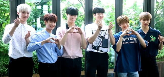 JinJin seen posing with his band members from Astro in 2017