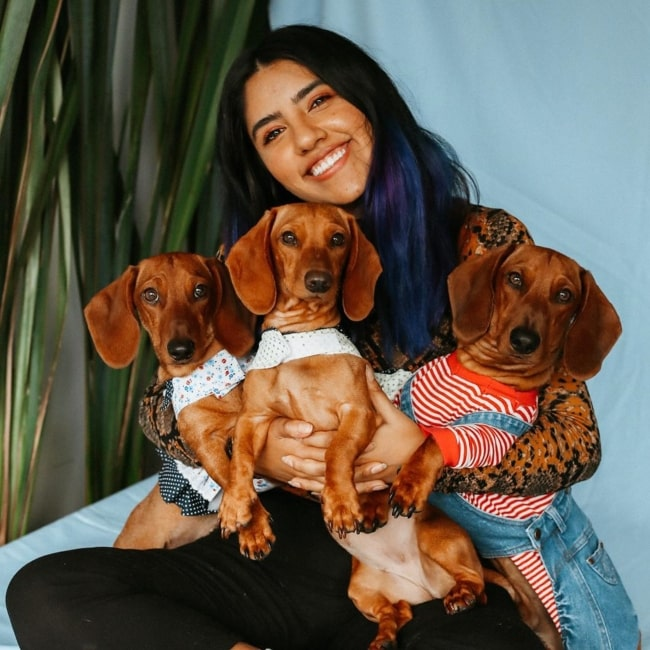Karen Polinesia as seen in a picture taken with her dogs Akiva, Kumi, Kalon in June 2020