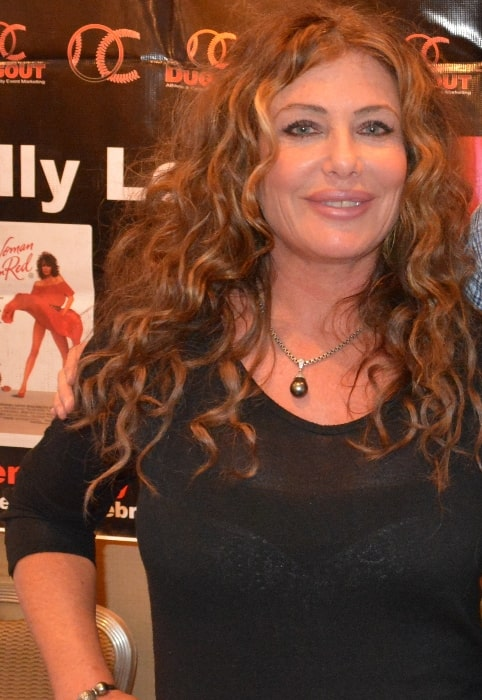 Kelly LeBrock as seen while smiling for a picture at the Chiller Theatre Expo at the Sheraton Parsippany Hotel in Parsippany, New Jersey in October 2014