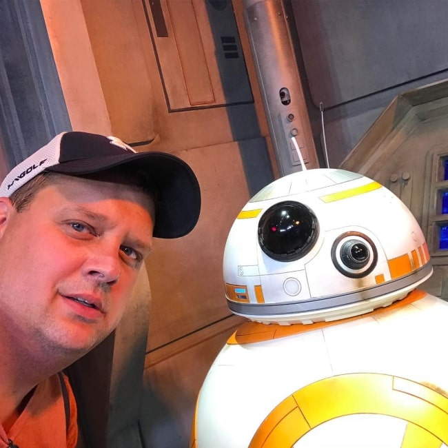 Ken Reese posing with Star Wars character BB-8 in July 2018