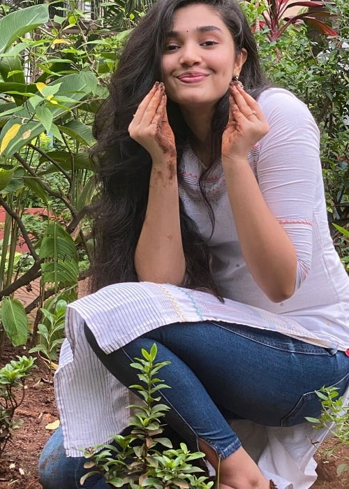Krithi Shetty posing for a picture while planting a sapling in July 2020