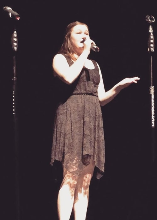 Kyla Rae Kowalewski in a picture taken while she sang the song Hey, Soul Sister by Train during a high school performance in January 2018