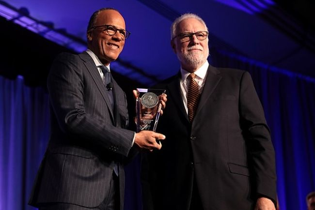 Lester Holt receiving the 2019 Walter Cronkite Award for Excellence in Journalism from Mark Searle