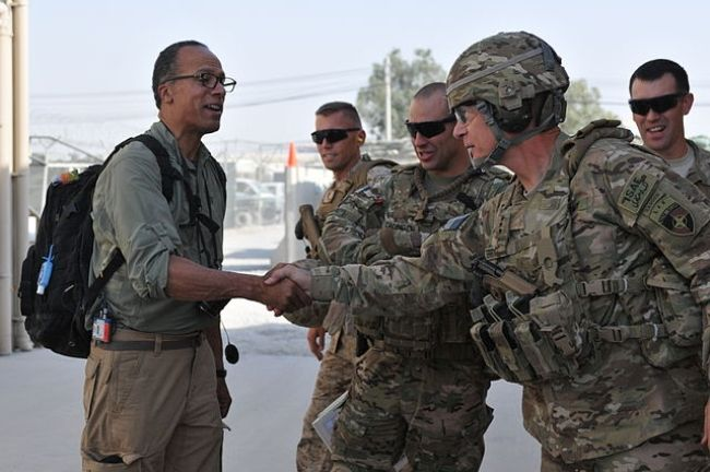 Lester Holt shaking hands with ISAF Joint Command Commander Lt. Gen. James Terry in 2012