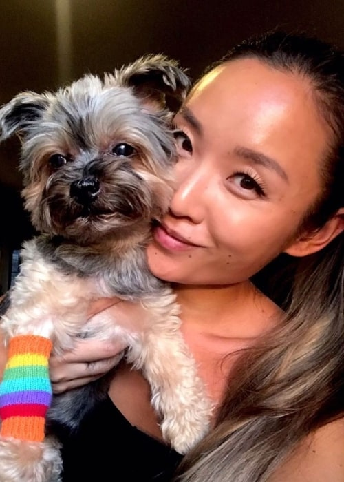 Li Jun Li posing for a picture along with her pet ToTo in New York City, New York in August 2019