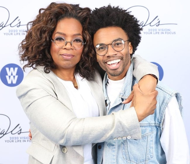 Luke Youngblood smiling in a picture alongside Oprah Winfrey in Los Angeles, California, United States