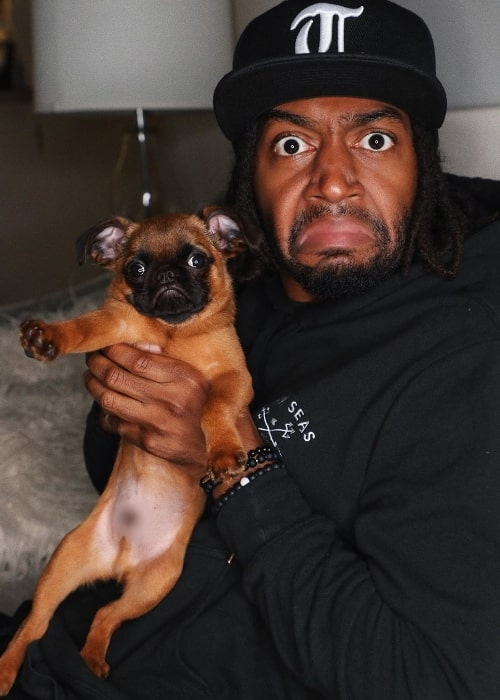 Marlon Webb as seen while posing for a picture with his dog in May 2019