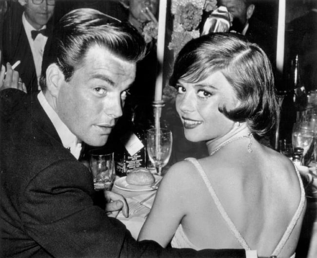 Natalie Wood smiling for a picture alongside husband Robert Wagner at the Academy Awards dinner in 1960