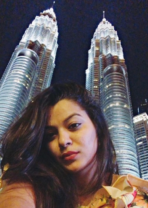 Nidhi Jha as seen in a selfie that was taken in front of the Petronas Twin Towers in Kuala Lumpur, Malaysia during a tour in the past