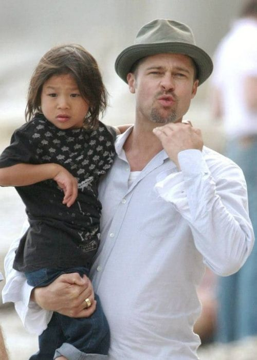 Pax Jolie-Pitt as seen in the arms of his father
