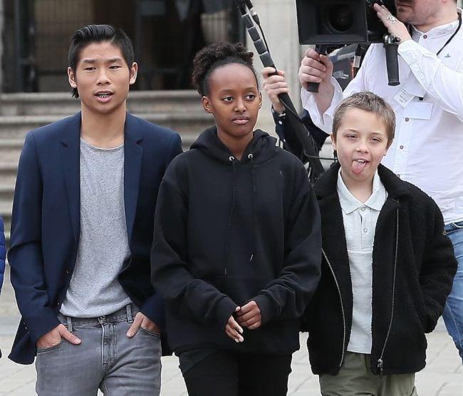 Pax seen with his siblings Zahara and Knox Léon