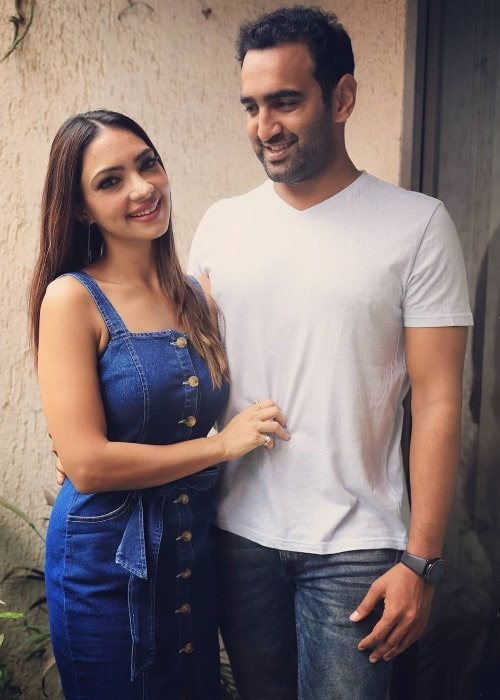 Pooja Banerjee as seen while posing for a picture alongside her husband Sandeep Sejwal in May 2020