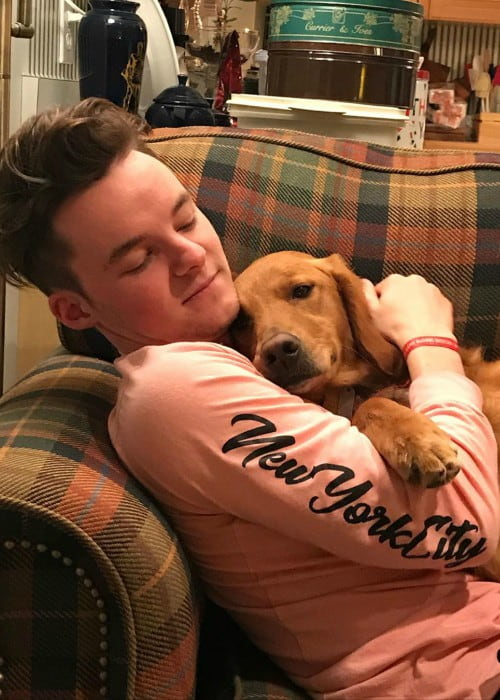 Ryan Prunty with his dog as seen in December 2019