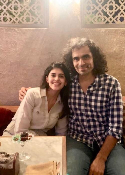 Sanjana Sanghi smiling for a picture alongside Imtiaz Ali in November 2019