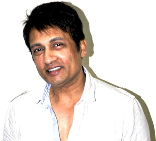 Shekhar Suman as seen while smiling for the camera