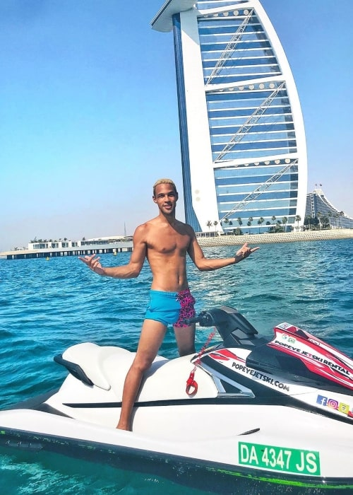 Simon Desue as seen while standing shirtless on a jet ski in front of the Burj Al Arab in Dubai in May 2020