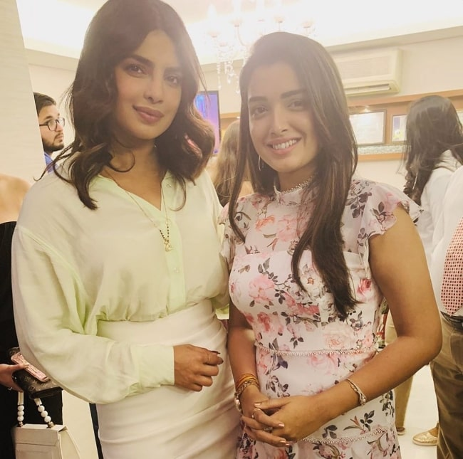 Amrapali Dubey (Right) as seen while smiling in a picture alongside Priyanka Chopra
