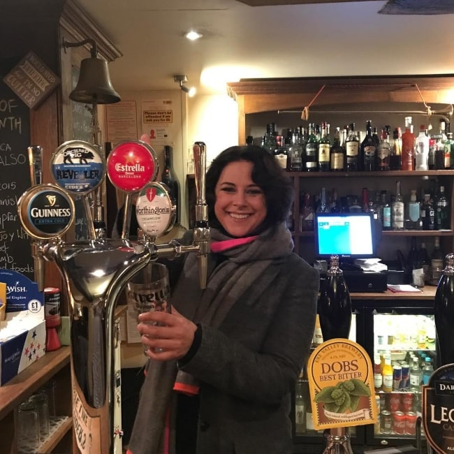 Belinda Stewart-Wilson enjoying a pint in the past