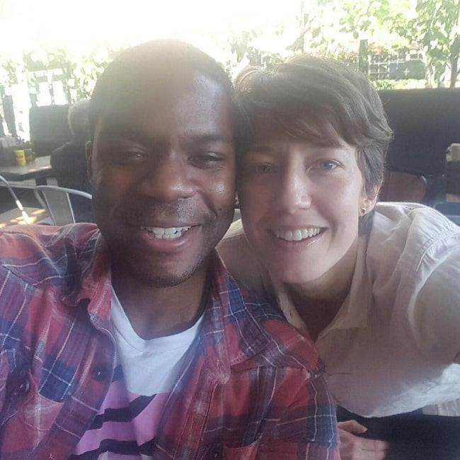 Carrie Coon as seen while smiling in a selfie alongside Jovan Adepo in Los Angeles, California in February 2017