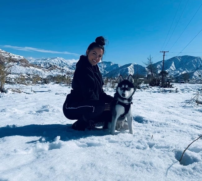 Constance Nunes posing for a picture along with her husky Buff in Wrightwood, California in December 2019