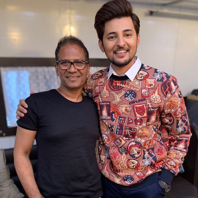 Darshan Raval smiling in a picture alongside Naushad Bhramer