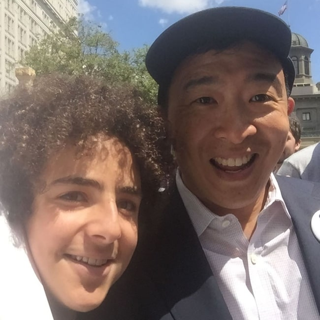 Elisha Henig (Left) as seen while smiling in a picture alongside Andrew Yang in Portland, Oregon in July 2019