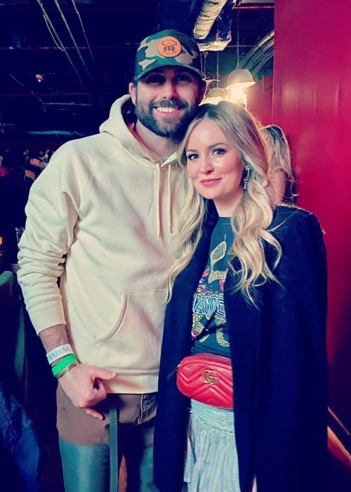 Emily Maynard posing for a picture alongside Tyler Johnson at the Fillmore Charlotte in Charlotte, North Carolina