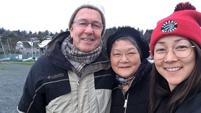 Emily Piggford smiling in a selfie along with her parents in December 2019